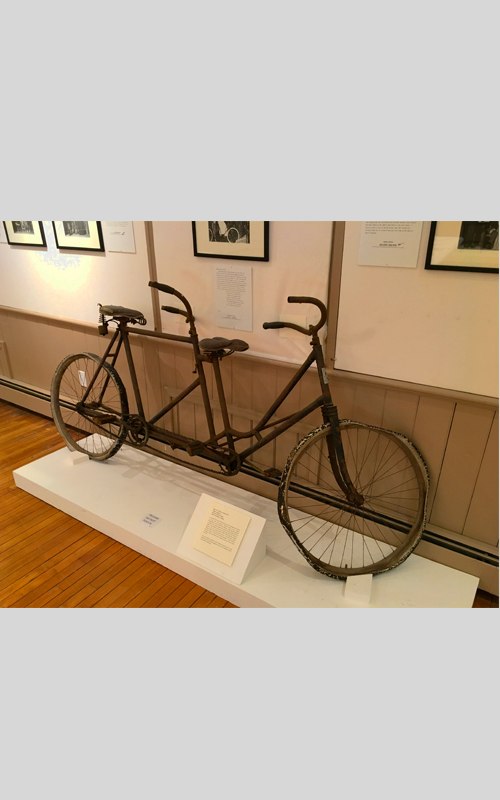 "<h3>Bicycle Built For Two</h3> <br> <p><i>Maker unknown</i><p> <br> <p><strong>1Early twentieth-century <br> Gift of George R. Latham</strong></p> <br> <br> <p>A tandem bicycle (a bicycle built for two) is designed to be ridden by more than one person. Tandem refers to the seating arrangement – one in front, others behind – rather than the number of riders. The earliest patents for tandem bicycles date from the  1890s – the decade of the craze for bicycling. <i>Daisy Bell (Bicycle Built for Two</i>) is a song written in 1892 with the famous chorus: ""Daisy, Daisy / Give me your answer, do. / I'm half crazy / all for the love of you. / It won't be a stylish marriage. / I can't afford a carriage. / But you'd look sweet / upon the seat of a bicycle built for two."" There are serious condition issues with this bicycle, but it is the tandem bicycle used in the pageant and is the only tandem bicycle in the OHS collections.</p>"