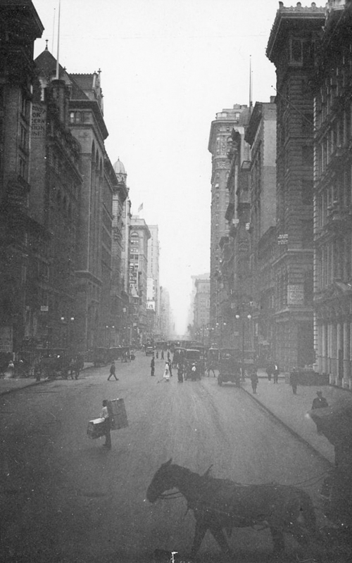 "<h3>Fifth Avenue at 18th Street</h3> <br> <p><i>William Steeple Davis</i><p> <br> <p><strong>Ca. 1915 <br> Gift of the William Steeple Davis Trust</strong></p> <br> <br> <p>Along with his many river views and photographs of individual buildings, Davis photographed Fifth Avenue – long the most prestigious of the major streets of New York. Here the view was Fifth Avenue at 18th Street, an area that is now part of the Ladies Mile Historic District. The Designation Report of 1989 states that ""Beginning about 1890, [Fifth] avenue began to undergo a transformation first with office buildings, many of which housed publishers and architects, and then in a short span of some fifteen years, beginning in the late 1890s, with numerous speculatively-built store and loft structures.""</p>"