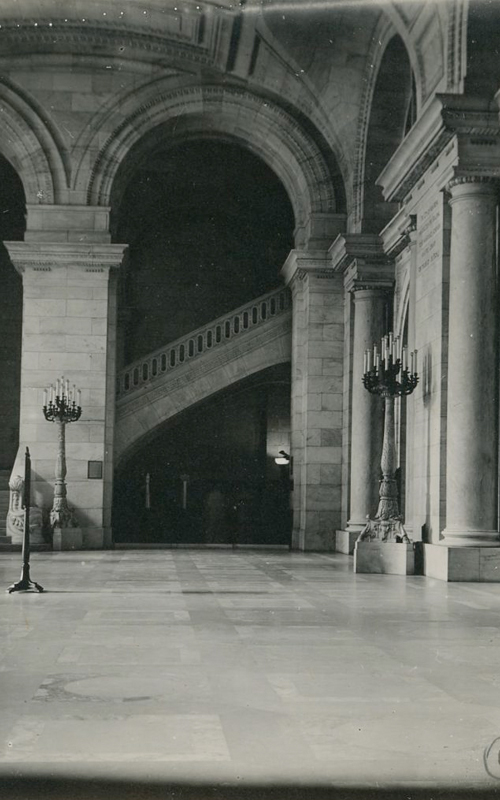 <h3>Entrance Hall, Public Library</h3> <br> <p><i>William Steeple Davis</i><p> <br> <p><strong>1915 <br> Gift of the William Steeple Davis Trust</strong></p> <br> <br> <p>This evocative photograph of the deserted and somber-looking entrance hall of the then recently-opened New York Public Library won second prize in Photo-Era magazine's Public Building contest. Rather than the usual WSD stamp, Davis has hastily drawn free hand the copyright symbol and date. Davis seems to have been more interested in the interior spaces of this masterful building by Carrere & Hastings rather than in the famous Fifth Avenue façade.</p>