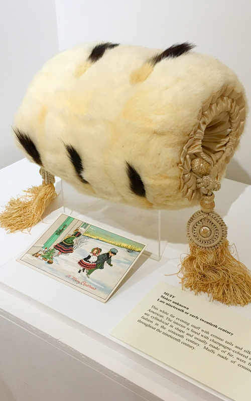 <h3>Muff</h3> <br> <p><i>Maker unknown</i></p> <strong>Late nineteenth or early twentieth century</strong> <br> <br> <p>This white fur evening muff with ermine tails and silk tassels is probably American. The interior is lined with champagne-colored satin. Muffs, which are cylindrical in shape and usually made of fur, were first introduced to fashion in the sixteenth century. Muffs made of ermine were popular throughout the nineteenth century.</p>