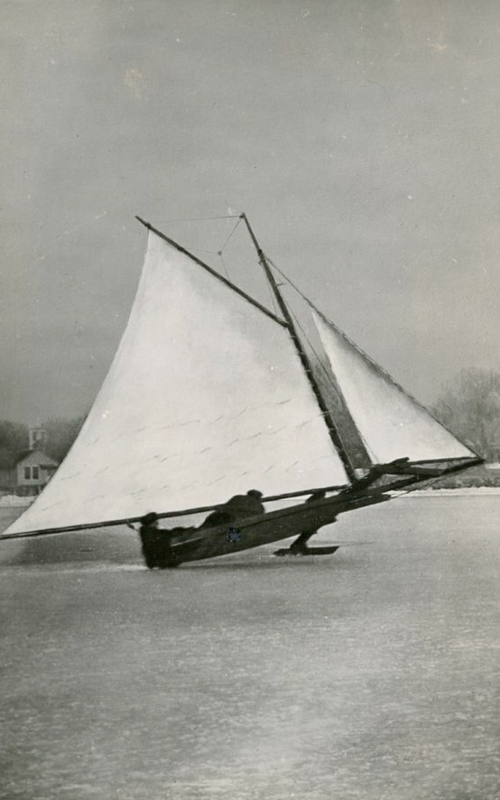 <h3>Ice Boat</h3> <br> <p><i>William Steeple Davis</i></p> <strong>1920 <br> Gift of the William Steeple Davis Trust</strong> <br> <br> <p>This photograph by Orient artist and photographer, William Steeple Davis, was on the February, 1920, cover of The Camera magazine. The image gives an excellent impression of a fast-moving ice boat. It is shown sailing in Orient Harbor; the steeple of the Methodist Church is just visible at the left.</p>