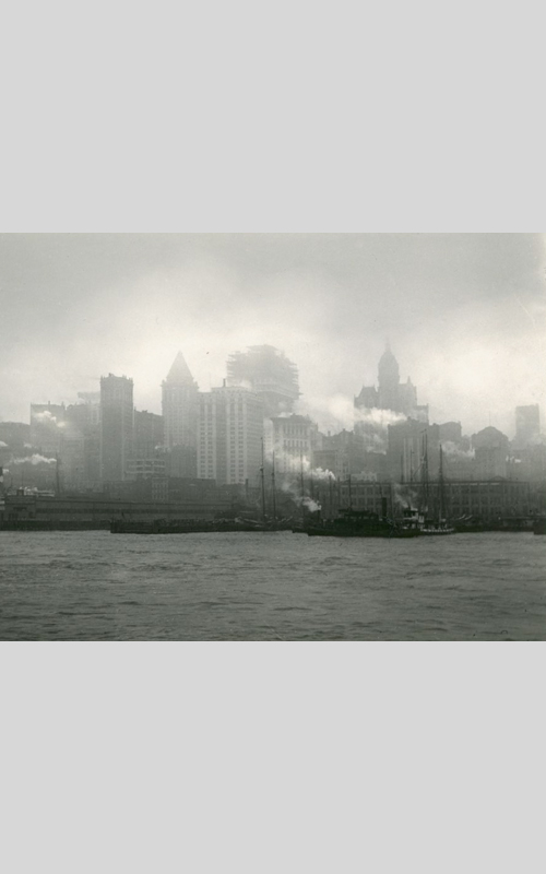 <h3>The City of Towers</h3> <br> <p><i>William Steeple Davis</i><p> <br> <p><strong>1914 <br> Gift of the William Steeple Davis Trust</strong></p> <br> <br> <p>This photograph was taken in August 1914 and was originally titled New York Waterfront from the East River. The rather prosaic title was probably changed when Davis sent the photograph to exhibitions and photo contests. (It was awarded a fourth prize in Rochester, and a third prize in an enlarging contest in Photo Works magazine.) The tallest of the towers depicted was the Singer building designed by architect Ernest Flagg and completed in 1908. For a year the Singer Building was the tallest in the world. It was demolished in 1968. The building shown under construction is probably the Equitable Building which opened in 1915. To its left in the photograph is the Bankers Trust Building with the stepped-pyramid top. The architect for Bankers Trust was Trowbridge & Livingston and the building opened in 1912.</p>