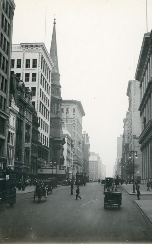 <h3>Fifth Avenue at 35th Street</h3> <br> <p><i>William Steeple Davis</i><p> <br> <p><strong>Ca. 1915 <br> Gift of the William Steeple Davis Trust</strong></p> <br> <br> <p>The most prominent landmark in this photograph is the Brick Presbyterian Church at the left. The original Brick church was built downtown in 1767 and demolished in 1857. In 1858 the congregation moved to the building depicted here at Fifth Avenue and 37th Street. Eighty years later, in 1938, this church was demolished. The Brick Church is currently at Park Avenue and 91st Street.  Another significant New York building can just be seen on the right – the Tiffany building built in 1905 by Stanford White and considered one of his finest buildings. (It is the structure with three tiers of columns).  Davis sent this photograph to at least three publications: Photo-Era, American Photography, and Camera where it was published in August 1922.</p>