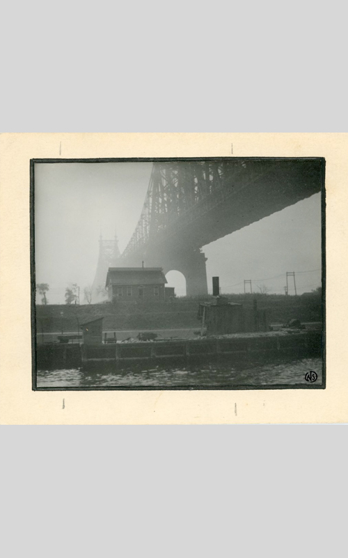 """<h3>Queensborough Bridge - Misty Morning</h3> <br> <p><i>William Steeple Davis</i><p> <br> <p><strong>Ca. 1915 <br> Gift of the William Steeple Davis Trust</strong></p> <br> <br> <p>This view of the Queensboro Bridge from below was illustrated in an article written by Davis entitled """"Clouds and Atmospheric Effects."""" This particular image, mounted on board by Davis, was outlined in black ink and signed with his stamp in the lower right-hand corner. The Queensboro Bridge, a cantilever bridge, was completed in 1909. It crosses the East River and Roosevelt Island (formerly known as Blackwell's Island and Welfare Island). The bridge is popularly known as the 59th Street Bridge, but since 2011 its official name is the Ed Koch Queensboro Bridge.</p>"""