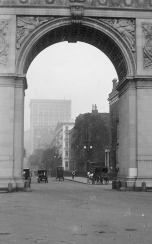 <h3>Washington Square Arch</h3> <br> <p><i>William Steeple Davis</i><p> <br> <p><strong>Ca. 1915  <br> Gift of the William Steeple Davis Trust</strong></p> <br> <br> <p>This photograph, with its close-up view of the Washington Square Arch, presents all the activity on Fifth Avenue taking place within the framework of the arch itself. This different vantage point presents an image quite unlike that of the other photograph in the exhibition which depicts a south-facing view of the arch. The original arch, built in 1889 to commemorate the centennial of Washington's inauguration, was made of wood and plaster. It proved so popular that the permanent arch of marble – designed by Stanford White – was erected in 1892.</p>