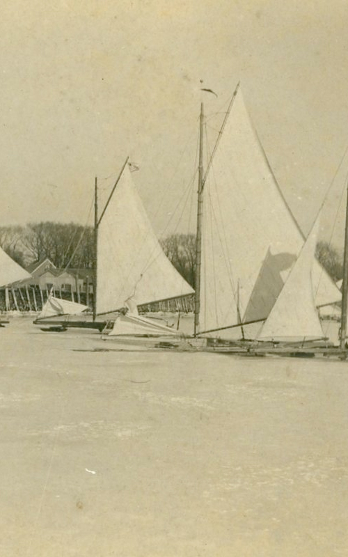 <h3>Ice Boats Near the Wharf</h3> <br> <p><i>Photographer unknown</i></p> <strong>Ca. 1904</strong> <br> <br> <p>Most of these early photographs of ice boats show ice boating in Orient Harbor; one hundred years later ice boating takes place – if at all – in the shallower Hallock's Bay.</p>
