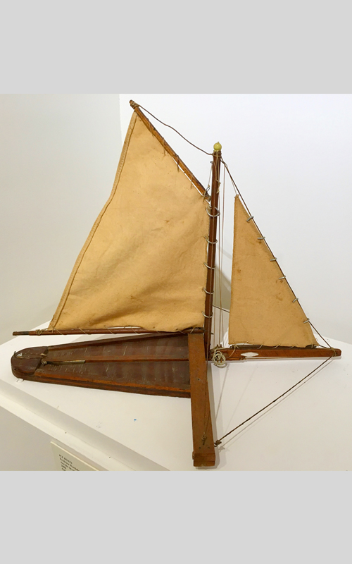"""<h3>Model of an Ice Boat</h3> <br> <p><i>Howard F. King</i></p> <strong>Mid-twentieth century <br> Gift of Esther King</strong> <br> <br> <p>This model of the iceboat """"Slim"""" was made by Howard F. King of Orient.</p>"""