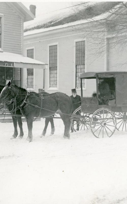 <h3>The Orient Post Office in Winter</h3> <br> <p><i>Photographer unknown</i></p> <strong>Ca. 1900</strong> <br> <br> <p>The stage shown here was driven by Elbert Tabor between Orient and Greenport. This building next to Poquatuck Hall served as the village post office for many years. The second floor was used as a village meeting room. The building was eventually sold to a barber who had his shop in the front and lived in the back. It is now a private residence.</p>