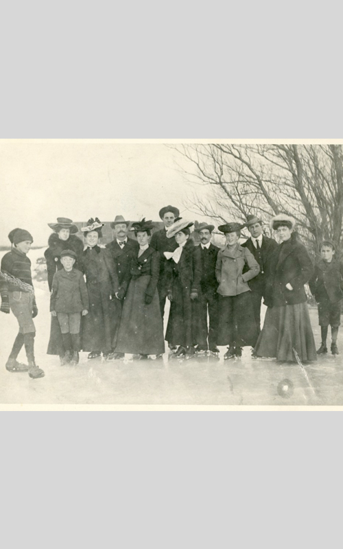 <h3>Ice Skaters in Orient</h3> <br> <p><i>Photographer unknown</i></p> <br> <strong>Ca. 1900</strong> <br> <br> <p>These thirteen people are shown skating on Major's Pond in Orient around 1900. They are all identified. In the front row (left to right) are: L. Vinton Richard, Seward B. King, Jess Vail, Carrie Westlake, Florence Douglass, Lillian Roberts, Flora Wilcox, and Ed Miller. In the back row (left to right) are: Nancy Latham, Eldridge Latham, Fred Terry, Sam Vail, and Fred Hommel.</i></p>