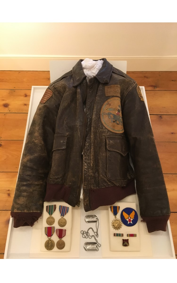 <h3>LEATHER FLIGHT JACKET and WORLD WAR II MEDALS</h3> <br> <p><strong>1940-1945</strong></p> <p><strong>Given in memory of Marcus Duvall by Robert Reeves, Jr.</strong></p> <br> <p>This well-preserved leather flight jacket was worn by Marcus Duvall during World War II. He served in the Army Air Force during the war flying many successful missions in a B-24 over Germany and in the Mediterranean theatre. Near the end of the war he was home on leave and, tragically, was killed in Greenport in a car accident. A number of Marcus Duvall's medals are also in the case. The original photograph showing him with his ten-member flight crew is down the hall in the Recent Acquisitions exhibition.</p>