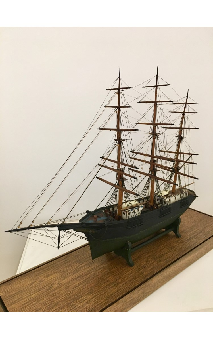 <h3>MODEL OF A THREE MASTED SHIP</h3> <br> <p><strong>Maker unknown</strong></p> <p><strong>Ca. 1870s-1880s</strong></p> <p><strong>Gift of Sam Vail</strong></p> <br> <p>This full-rigged three-masted ship model was painted green and black. It is of an unidentified vessel made by an unidentified member of its crew. We do know that the master of the ship was Captain Warren L. Beebe (1818-1876). We do not know which of the ships he commanded is represented by this model. Captain Beebe lived on Village Lane and is buried in Orient's Central Cemetery. Sam Vail, the donor, lived in what is now the director's house on the OHS campus.</p>