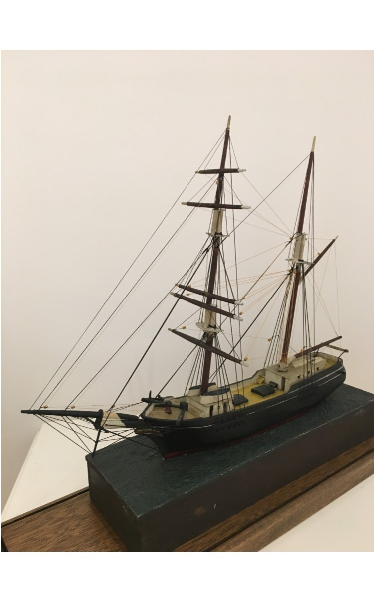 <h3>MODEL OF THE BRIGANTINE <em>VIM</em></h3> <br> <p><strong>Attributed to George H. Cleveland</strong></p> <p><strong>Late-nineteenth or early-twentieth century</strong></p> <p><strong>Gift of Emily Schummann</strong></p> <br> <p>The model of the brigantine Vim of Sag Harbor is mounted on a green-painted wooden base. It is thought to have been made by George H. Cleveland. He was the son of John D. Cleveland, the Orient blacksmith whose shop was at the bottom of what is now Village Lane just near the wharf. The donor was the granddaughter of the blacksmith. Interestingly, although the rigging is nicely done and in excellent shape, the cabins seem crudely constructed. A brigantine has two masts. The foremast has square sails and the aftermast is fore-and-aft rigged.</p>