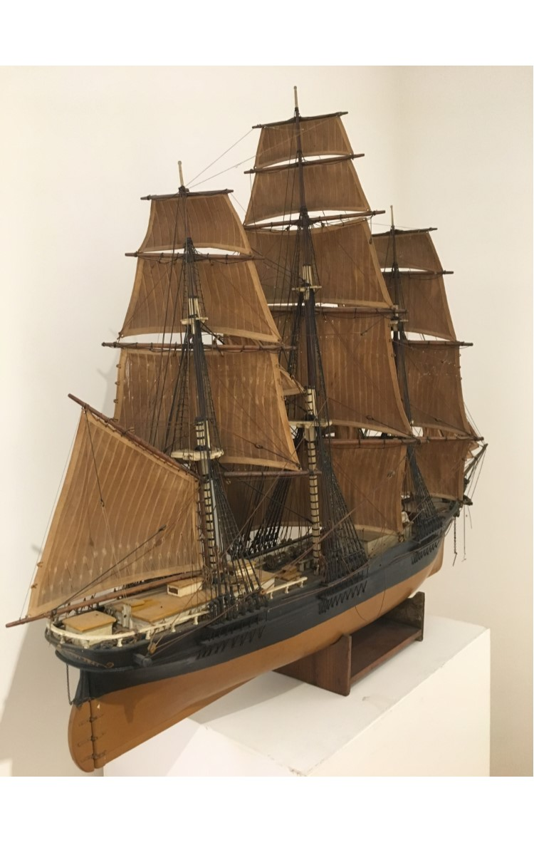 """<h3>MODEL OF THE <em>SOVEREIGN OF THE SEAS</em></h3> <br> <p><strong>Maker unknown</strong></p> <p><strong>Nineteenth century</strong></p> <p><strong>Gift of George R. Latham</strong></p> <br> <p>Very little is known about this large ship model, but a great deal is known about the ship itself. The famous clipper ship Sovereign of the Seas was built by East Boston ship builder Donald McKay in 1852. Two years later, in 1854, Sovereign of the Seas recorded the fastest speed ever for a sailing ship – 22 knots. The record held for almost 100 years. It was considered the largest merchant ship in the world when it was built. The Boston Daily Atlas of 1852 wrote a lengthy and glowing report on the ship praising its beauty """"her bow rises boldly, and is beautiful beyond description,"""" its """"strength of construction and completeness of equipment aloft,"""" and concludes that for all those things """"she has no superior"""". Only seven years after being launched, in 1859, she was wrecked on the Pyramid Shoal in the Straits of Malacca on a voyage from Hamburg to China.</p> <br> </p>As you can see, the model is not in good condition, but the decision was made to show it despite its obvious problems. We have established a Maritime Collection Conservation Project at OHS in hopes that you will help restore this splendid model and others that are on view or in storage.</p>"""