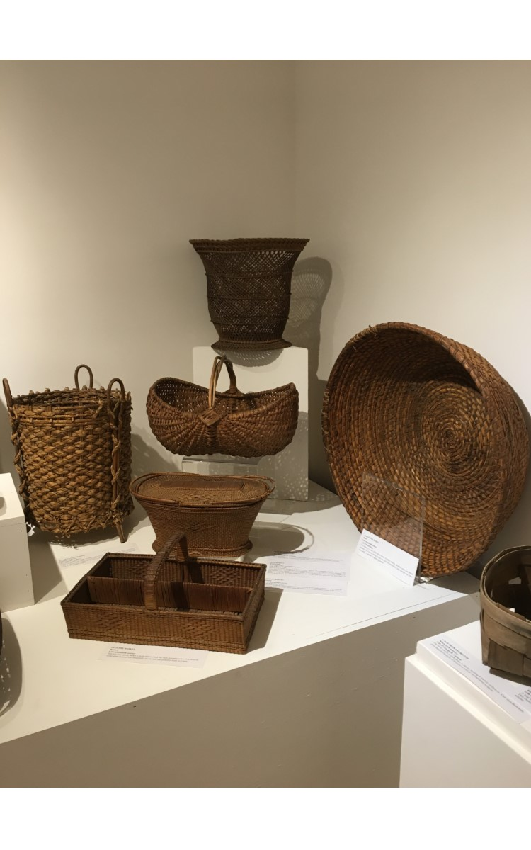 """<h3>WASTEPAPER BASKET</em></h3> <br> <p><strong>Wicker</strong></p> <p><strong>Ca. 1900</strong></p> <p><strong>Gift of George R. Latham</strong></p> <br> <p>This decorative open-weave wicker basket has been designed in an urn shape and was most likely used as a wastepaper basket. The weaving here is particularly skillful.</p> <br> <br> <hr> <br> <br> <h3>EGG BASKET</h3> <br> <p><strongFruitwood</strong></p> <p><strong>First half of the twentieth century</strong></p> <p><strong>Gift of Floyd King</strong></p> <br> <p>This type of woven basket is called a """"ribbed"""" basket. This example is in the classic shape of an egg basket, although there are variations. This particular type is """"melon-shaped."""" An egg basket with a more pronounced shape is known as a """"butt"""" or """"buttocks"""" basket. In basket making the diamond shape where the handle and rim intersect, as seen here, is known as a """"God's Eye.""""</p> <br> <br> <hr> <br> <br> <h3>SEWING BASKET</h3> <br> <p><strong>Rattan</strong></p> <p><strong>Late nineteenth century</strong></p> <p><strong>Gift of George Terry</strong></p> <br> <p>This two-handled, lidded basket is thought to have been made in China or elsewhere in Southeast Asia where the rattan plant flourishes. It is a cane-weave. Cane is the exterior of the rattan plant.</p> <br> <br> <hr> <br> <br> <h3>CUTLERY BASKET</h3> <br> <p><strong>Rattan</strong></p> <p><strong>Late-nineteenth century</strong></p> <br> <p>This is a very sturdy basket to hold flatware and has been strengthened with a piece of wood at the bottom. It is beautifully woven and was probably made in China.</p> <br> <br> <hr> <br> <br> <h3>THREE LEGGED BASKET</h3> <br> <p><strong>Braided Sea Grass</strong></p> <p><strong>Late-nineteenth century</strong></p> <br> <p>This unusual basket is made of braided sea grass, or possibly iris leaves. It was probably factory made, but the maker is unknown. There is an old label on the bottom marked """"J.U.8.S."""" however this offers no clues as to its origin. It may ha"""