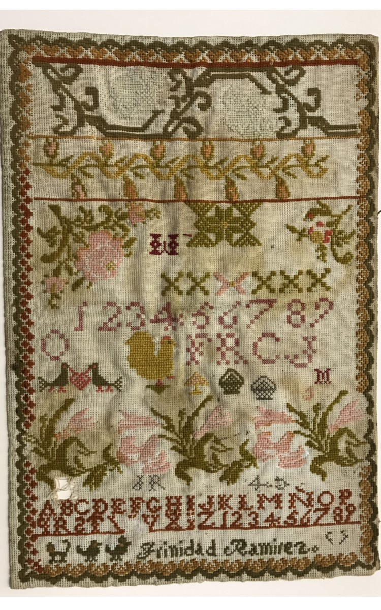 <h3>Trinidad Ramirez Sampler</h3> <br> <p><strong>Ca. 1890</strong></p> <p><strong>Gift of Sharon Elmore</strong></p> <br> <p>Trinidad Ramirez was a relative of Donald Boerum, who for many years was superintendent of the Oysterponds School. In recognition of his long-time involvement with OHS, our research library is named in his honor. This sampler was donated by his niece with an attached note: Sampler made by Trinidad Ramirez, Dad's sister about 1890, For Donald Boerum. With its variety of stitches, patterns, and borders as well as its depictions of birds, chickens and flowers, this is one of the most accomplished and colorful samplers in the OHS collection.</p>