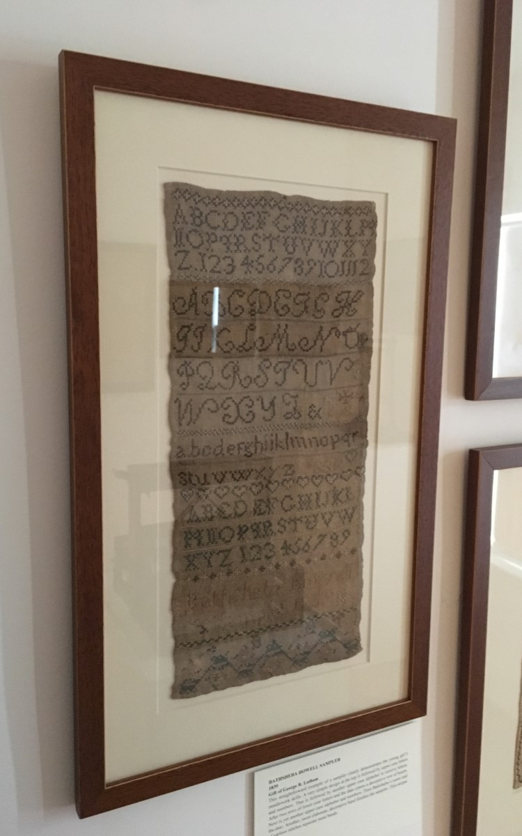 <h3>Bathsheba Howell Sampler</h3> <br> <p><strong>1839</strong></p> <p><strong>Gift of George R. Latham</strong></p> <br> <p>This straightforward example of a sampler clearly demonstrates the young girl's needlework skills. A very simple design at the top is followed by upper case letters and numbers. That is followed by another upper case alphabet in cursive letters. After two rows of lower case letters and the date comes a decorative row of hearts. Next is yet another upper case alphabet and numbers. Then Bathsheba's name and the date. Another, more elaborate, decorative band finishes the sampler. Thin stripes of various stitches separate most bands.</p>