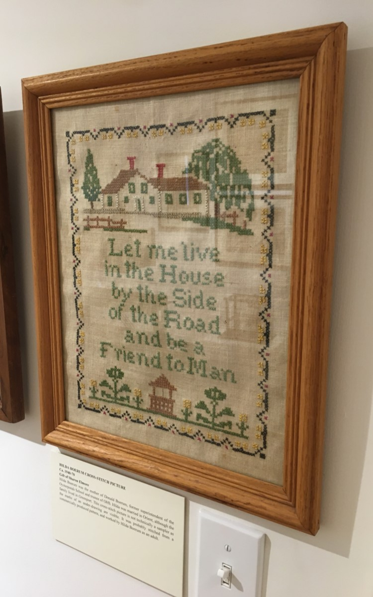 <h3>Hilda Boerum Cross-Stitch Pattern</h3> <br> <p><strong>Ca. 1940-1970</strong></p> <p><strong>Gift of Sharon Elmore</strong></p> <br> <p>Hilda Boerum was the mother of Donald Boerum, former superintendent of the Oysterponds School and trustee of OHS. Hilda was married in Orient, although the family lived in Greenport. This cross-stitch picture is not technically a sampler as the marks of an under-drawing are visible. It was probably stitched from a commercially produced pattern, and worked by Hilda Boerum as an adult.</p>